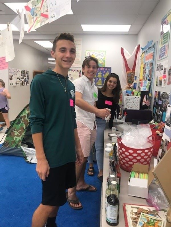 KWHS students stop by to bring some Holiday Help to our Elementary students